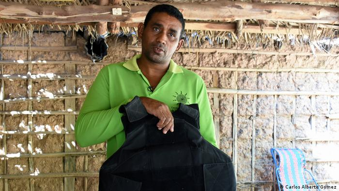 Environmental activists in El Hatillo in Colombia's César Department protect themselves with bulletproof vests
