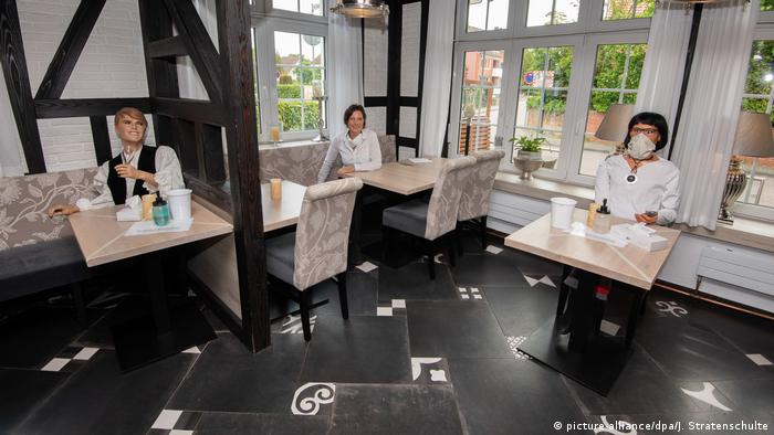 Mannequins sit at tables in a restaurant in Lower Saxony, Germany