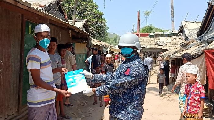 Navy personnel conduct a COVID-19 awareness campaign inside the refugee camp in Cox's Bazar, Bangladesh