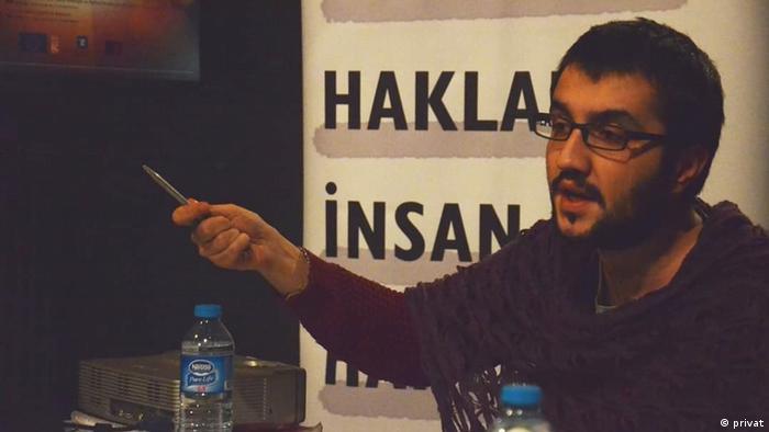 Yildiz Tar, man gestures with a pen