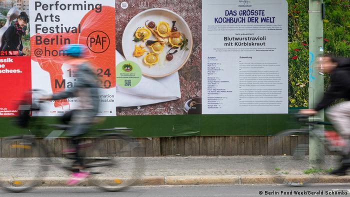 Bikeriders speeding past a poster