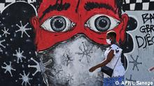 Coronavirus Elfenbeinküste Abidjan Graffito