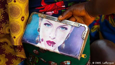 A purse sold at a market in the Ivory Coast depicting a woman with light skin