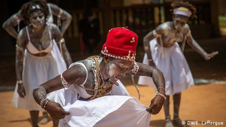 Young girls dance with their bodies coated in kaolin in Aniansue, Ivory Coast
