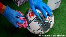 A football is disinfected before a game