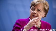 April 23, 2020*** German Chancellor Angela Merkel gives a press conference following the European Council video conference, in Berlin, Germany, Thursday April 23, 2020. (Michael Kappeler/DPA via AP)  