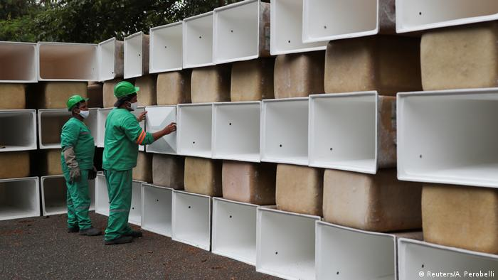 Men prepare to install new spaces for coffins at the Sao Pedro municipal cemetery