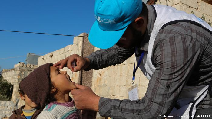 A vaccination campaign in the town in Taqd, in the western Aleppo countryside, to protect children between one and five years-old against polio