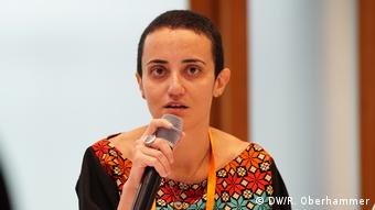 Lina Attalah speaks at a microphone