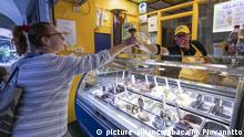 A kid gets an ice-cream in Turin, Italy on May 17, 2020. After the lift of the lockdown many small businesses have restarted observing restrictive rules, like wearing face masks, gloves, 1 meter distance, one client for 14 square meters. Photo by Marco Piovanotto/ABACAPRESS.COM |