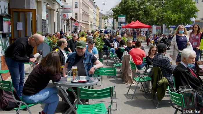 Tables outside cafes on Yppenplatz in Vienna