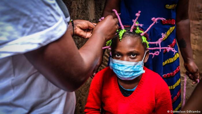 A child with hair styled in the shape of the coronavirus