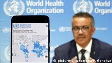Ukraine: In this photo illustration the World Health Organization (WHO) Director General Tedros Adhanom Ghebreyesus is seen on a screen of pc and a WHO coronavirus cases map displayed. April 29, 2020 file photo. (picture-alliance/dpa/P. Gonchar)