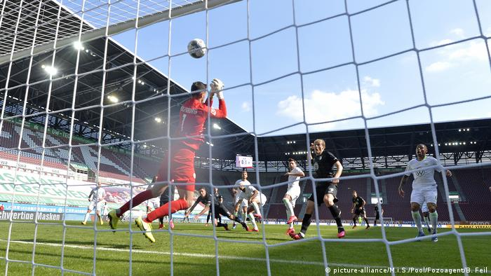 A view from behind the goal as John Anthony Brooks of Wolfsburg scores