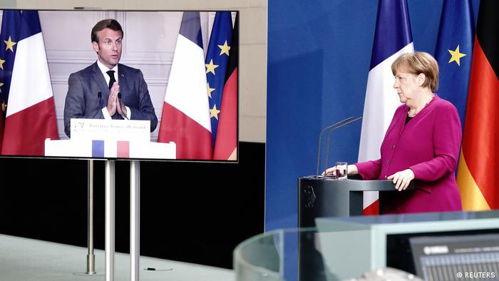 German Chancellor Angela Merkel holds a joint video news conference with French President Emmanuel Macron in Berlin