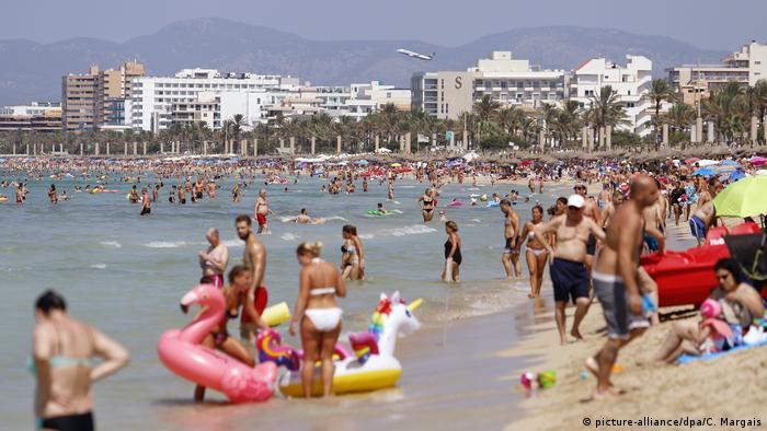 the beach of El Arenal, Mallorca is full of people