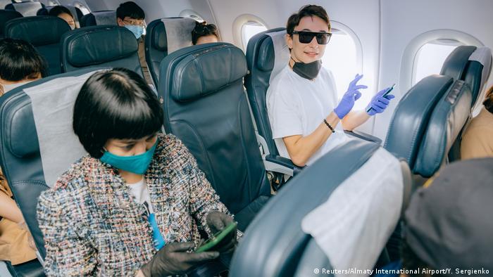 Passengers of a flight to Nur-Sultan sit inside a plane before take-off at Almaty International Airport, Kazakhstan May 1, 2020. (Reuters/Almaty International Airport/Y. Sergienko)