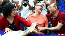 This photo taken on May 18, 2020 shows Mao Yin (C) speaking with his mother Li Jingzhi (L) and father Mao Zhenping (R) in Xian, in China's northern Shaanxi province. - A Chinese man who was kidnapped as a toddler 32 years ago has been reunited with his biological parents, after police used facial recognition technology to track him down. (Photo by STR / AFP) / China OUT