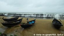 20.05.2020 *** 20.05.2020 *** A man anchors boats at the Tajpur Beach ahead of the expected landfall of cyclone Amphan in Midnapore, West Bengal, on May 20, 2020. - Several million people were taking shelter and praying for the best on May 20 as the Bay of Bengal's fiercest cyclone in decades roared towards Bangladesh and eastern India, with forecasts of a potentially devastating and deadly storm surge. (Photo by Dibyangshu SARKAR / AFP) (Photo by DIBYANGSHU SARKAR/AFP via Getty Images)