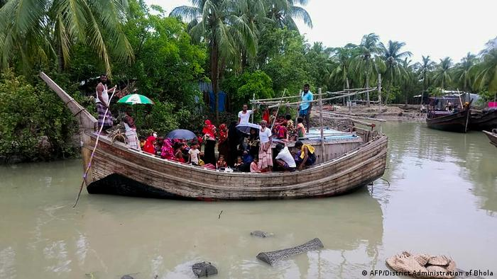 Residents from Dhalchar village being evacuated in a fishing trawler on the island of Bhola as Cyclone Amphan barrels towards Bangladesh's coast