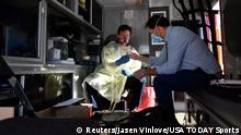 May 9, 2020; Jacksonville, Florida, USA; Members of the media get a COVID-19 coronavirus antibody test before UFC 249 at VyStar Veterans Memorial Arena. Mandatory Credit: Jasen Vinlove-USA TODAY Sports