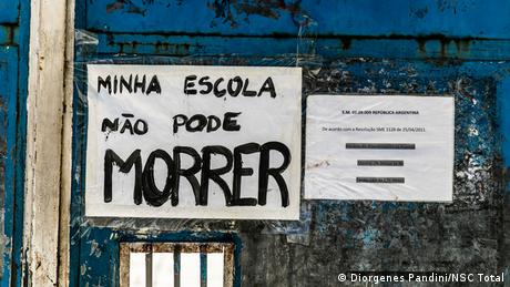 My school must not die, reads a sign written by a student on the gate of Republica Argentina High School in Rio de Janeiro, Brazil