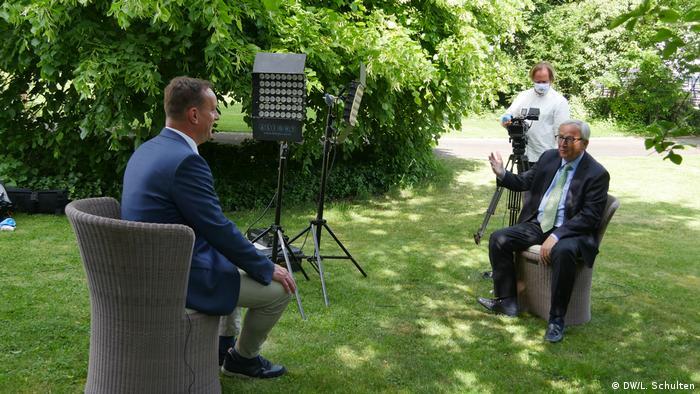Jean-Claude Juncker speaking to DW's Bernd Riegert in his garden.