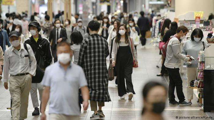 Shoppers walk in Kobe's commercial area on May 21, 2020, as a coronavirus state of emergency is set to be lifted in the western Japan city later in the day