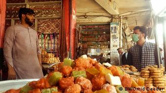 Торговец в афганском городе Асадабад