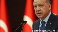 Turkish President Recep Tayyip Erdogan speaks during a press conference held after the coordination meeting to fight against the novel coronavirus, COVID-19, at the Cankaya Palace in Ankara on March 18, 2020. - President Recep Tayyip Erdogan announced on March 18, 2020, a $15 billion package to help the Turkish economy cope with the crisis over the new coronavirus, and urged Turks to leave their homes as little as possible. Turkey has so far recorded one death and 98 cases. (Photo by Adem ALTAN / AFP) (Photo by ADEM ALTAN/AFP via Getty Images)