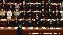 Delegates applaud as Chinese President Xi Jinping arrives for the opening session of China's National People's Congress (NPC) at the Great Hall of the People in Beijing, Friday, May 22, 2020. (AP Photo/Ng Han Guan, Pool) |