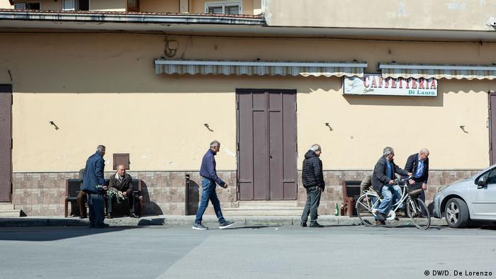 Men walking in downtown Casal Di Principe