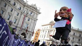 Berlusconi puppet in a demonstration in rome