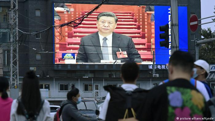A large screen on a street in Beijing shows Chinese President Xi Jinping attending the opening ceremony of the National People's Congress