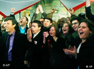 Supporters of the French Socialist Party cheer at the party's headquarters in Paris Sunday, March 14, 2010. The Socialist-led left is leading over France's President Nicolas Sarkozy conservative party in the first round of regional elections.(AP Photo/Michel Euler)