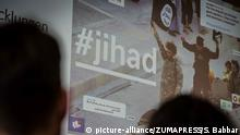 """March 5, 2020, Munich, Bavaria, Germany: The word ''Jihad'' displayed during a presentation by the state of Bavaria. Using the title of """"Antworten auf Salafism 2.0"""" (Answers to Salafism 2.0), the Bayerischen Netzwerks fÃÂ_r PrÃÂ_vention und Deradikalisierung gegen Salafismus explained the roles of digital media in the radicalization of Salafists and presented prevention and deradicalization strategies. Discussed were the common origins of modern Islamist and right-extremist/white nationalist internet campaigns and their ongoing similarities. Bavarian Interior Minister Joachim Herrmann was joined by Justizminister Georg Eisenreich, Social Minister Carolina Trautner, and internationally-renowned terrorism expert Dr. Peter Neumann. (Credit Image: © Sachelle Babbar/ZUMA Wire 