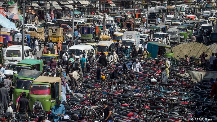 Motorists are seen in a traffic jam as people arrive at the Raja Bazar for shopping ahead of the Eid al-Fitr festival (AFP/F. Naeem)