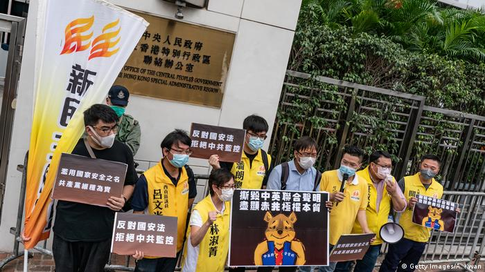 Pro-democracy supporters hold placards and shout slogans as they take part in a rally outside of Chineses Liaison Office on May 24, 2020 (Getty Images/A. Kwan)