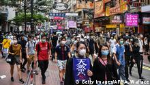 Protesters march on a road during a pro-democracy rally against a proposed new security law in Hong Kong on May 24, 2020. - The proposed legislation is expected to ban treason, subversion and sedition, and follows repeated warnings from Beijing that it will no longer tolerate dissent in Hong Kong, which was shaken by months of massive, sometimes violent anti-government protests last year. (Photo by Anthony WALLACE / AFP) (Photo by ANTHONY WALLACE/AFP via Getty Images)