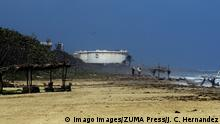 20.02.2020 February 20, 2020, Puerto Cabello, Carabobo, Venezuela: February 20, 2020. Two women walk along the beach while in the background you can see the El Palito refinery, located in Puerto Cabello, Venezuela..The United States continues to impose sanctions that directly affect the state oil company PDVSA and recently the Rosneft of Russia for its relations with the Nicolas Maduro government. Photo: Puerto Cabello Venezuela PUBLICATIONxINxGERxSUIxAUTxONLY - ZUMAhe3 20200220zbphe3004 Copyright: xJuanxCarlosxHernandezx