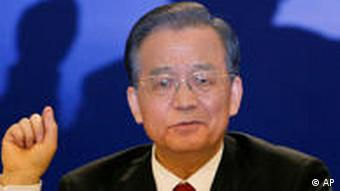 China's Premier Wen Jiabao gestures during his annual news conference following the closing session of the National People's Congress in Beijing's Great Hall of the People, China, Sunday, March 14, 2010. (AP Photo/Vincent Thian)