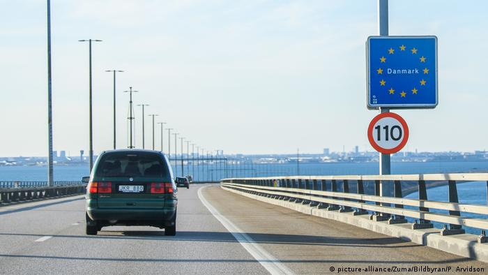 A car drives over the Oresund Bridge that connects Malmo and Copenhagen
