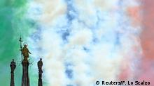 The Madonnina, a statue of the Virgin Mary atop Duomo cathedral, is seen during a performance of the Frecce Tricolori of the Italian Air Force as they perform to show unity and solidarity following the outbreak of the coronavirus disease (COVID-19), in Milan, Italy, May 25, 2020. REUTERS/Flavio Lo Scalzo