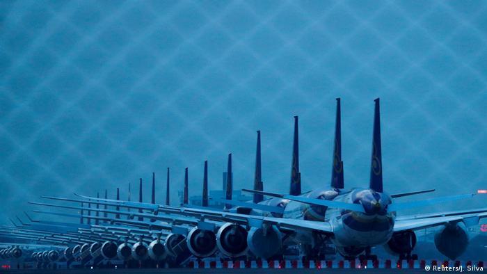 Thai Airways planes sit idle on the tarmac of Suvarnabhumi Airport in Bangkok