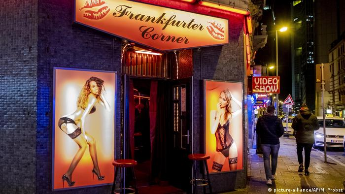 People walk through the red light district in Frankfurt, Germany