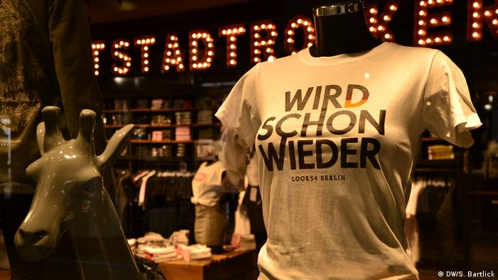 Mannequin wearing a t-shirt inscribed with Es wird schon - meaning it's gonna be ok
