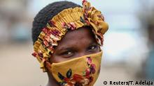 Uche Helen, a Nigerian student, 17, poses for a picture with a fabric face mask matching her head-band, following the spread of the coronavirus disease (COVID-19) in Lagos, Nigeria May 13, 2020. Picture taken May 13, 2020. REUTERS/Temilade Adelaja