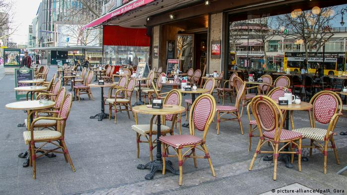 Empty chairs and tables outside a café in Berlin