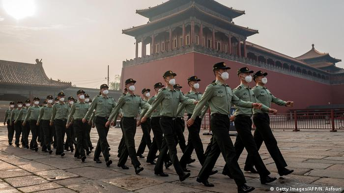Chinese People's Liberation Army soldiers marching in Beijing in May 2020