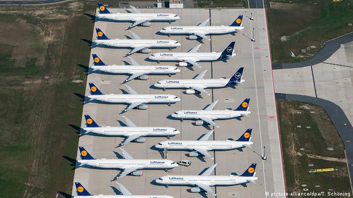 A dozen Lufthansa planes on the ground